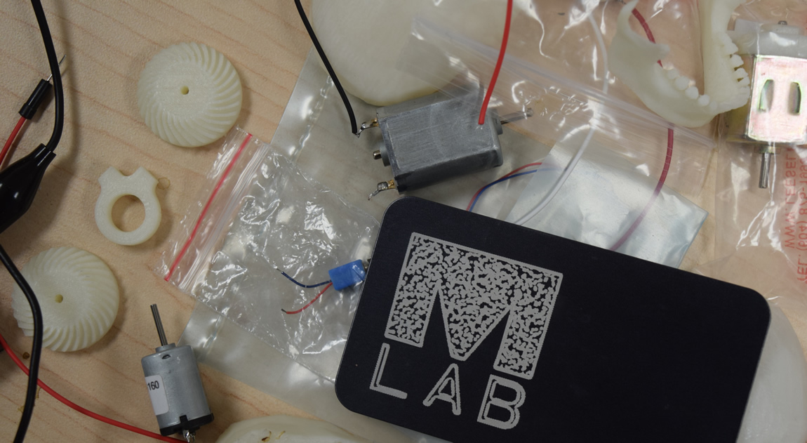 Materials from the MLab's prototyping space, including  anodized aluminum cut with the MLab logo