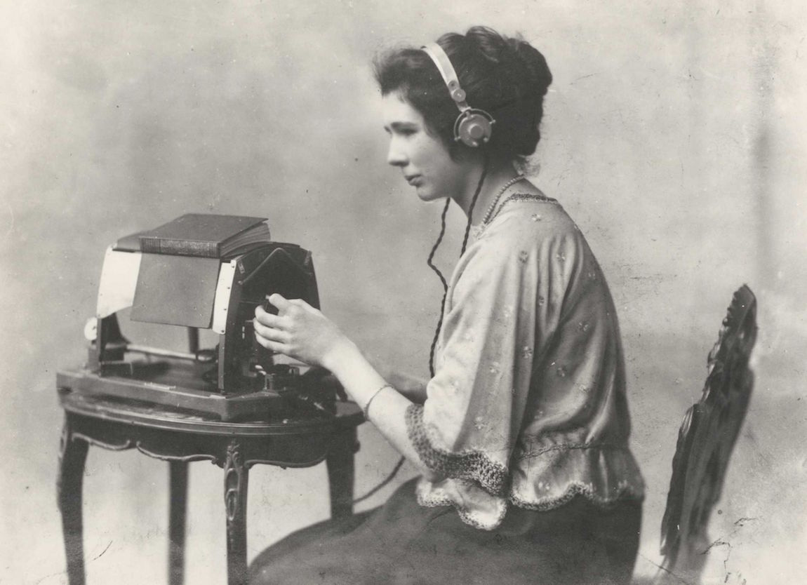 Mary Jameson reading Anthony Trollope's The Warden on an optophone, ca. 1921, care of Blind Veterans UK.