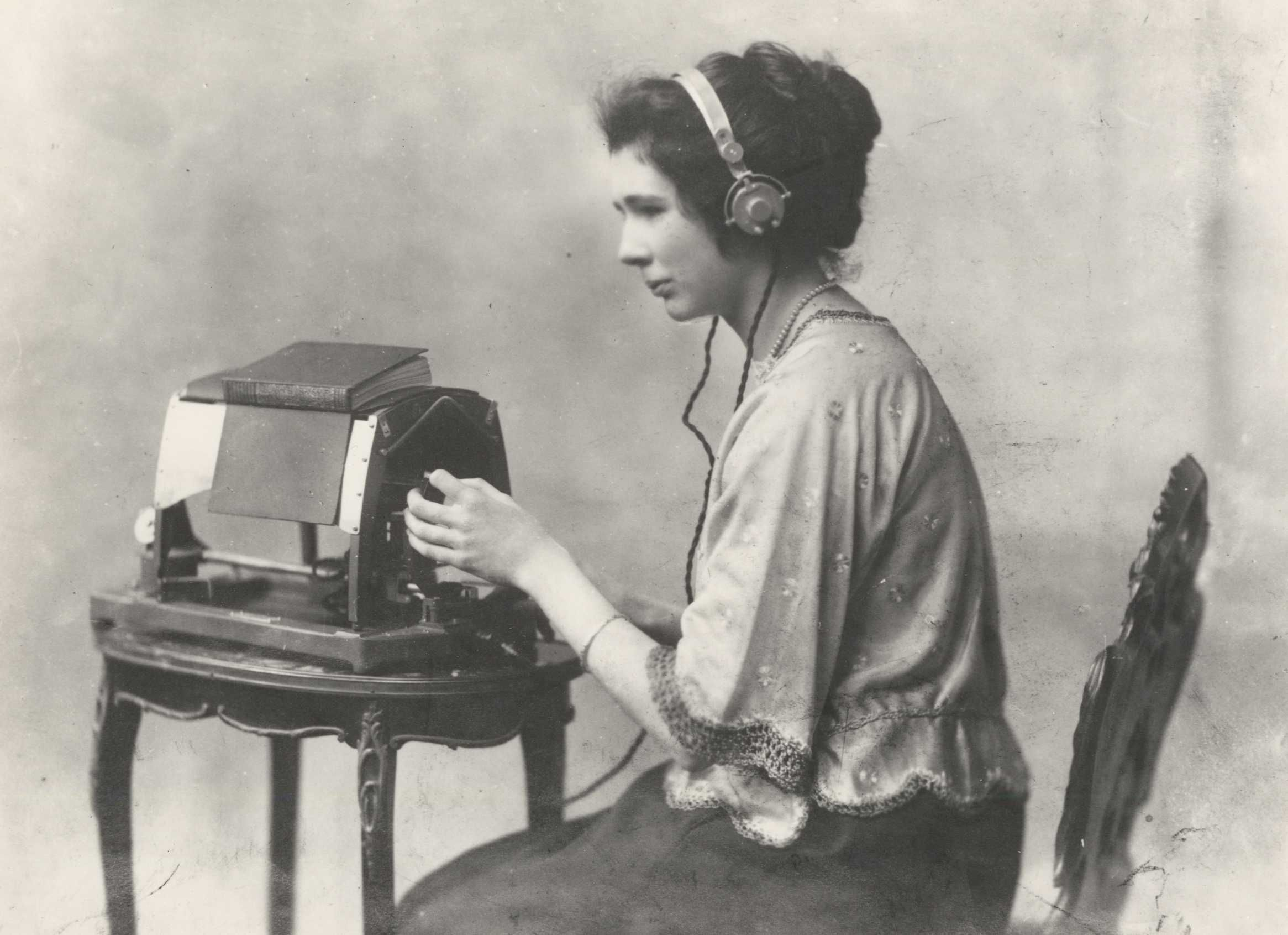 Mary Jameson reading Anthony Trollope's The Warden on an optophone, ca. 1921, care of Blind Veterans UK